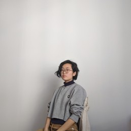Artist Florence Yee standing against white background